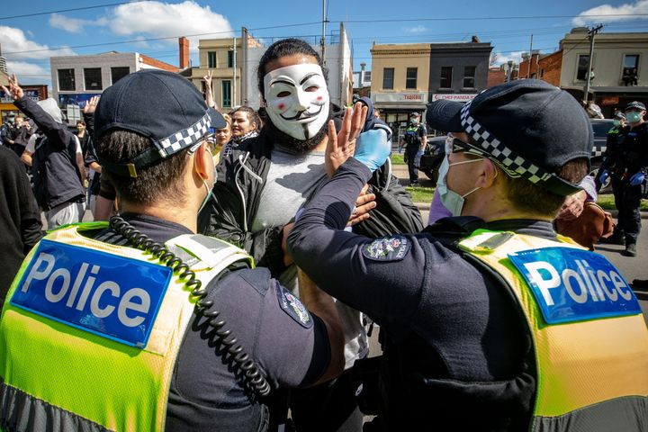 """Anti-lockdown protesters organised a """"freedom walk"""" to demonstrate against Melbourne's current Stage 4 COVID-19 restrictions."""