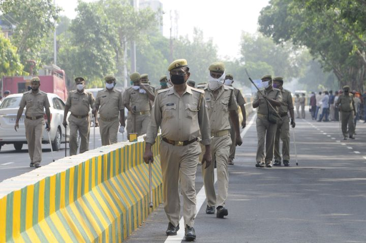 Police personnel stand guard outside the Covid Hospital in Sector 39, on August 8, 2020 in Noida.
