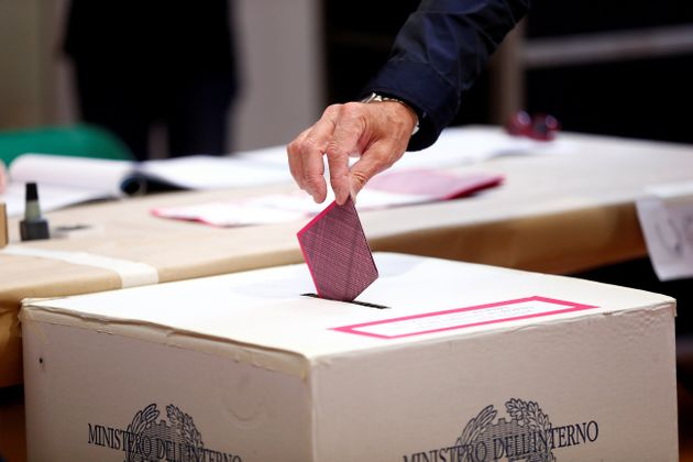 A man casts his vote for the European Parliament elections at a polling station in Rome, Italy May 26,...