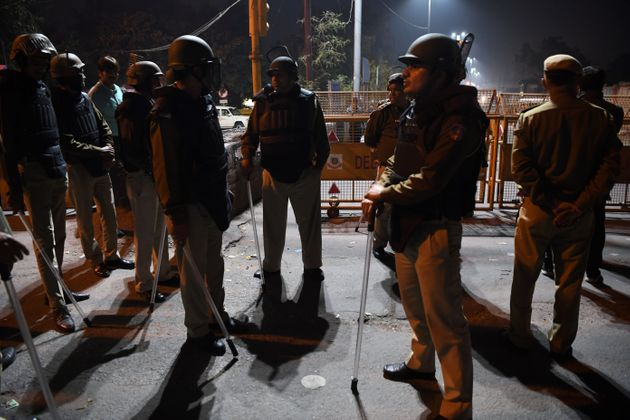 Police patrolling a riot-hit area following violence in New Delhi on February 25,