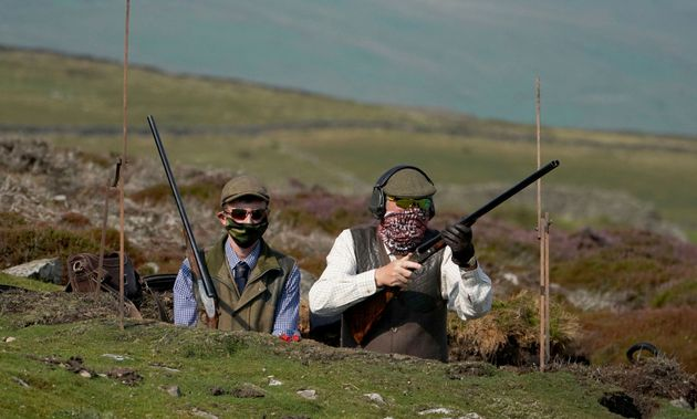 Members of a shooting party as the Glorious 12th, the official start of the grouse shooting season, gets