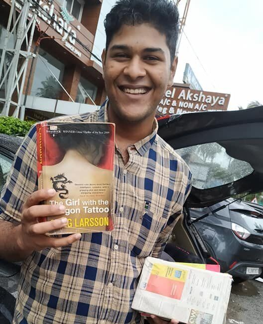 Alan displays a book presented to him by his mother Sabitha Sekhar after his release from Viyyur Central...