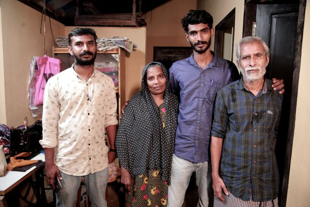 Thaha with his parents and elder brother after reaching his Kozhikode residence on Friday