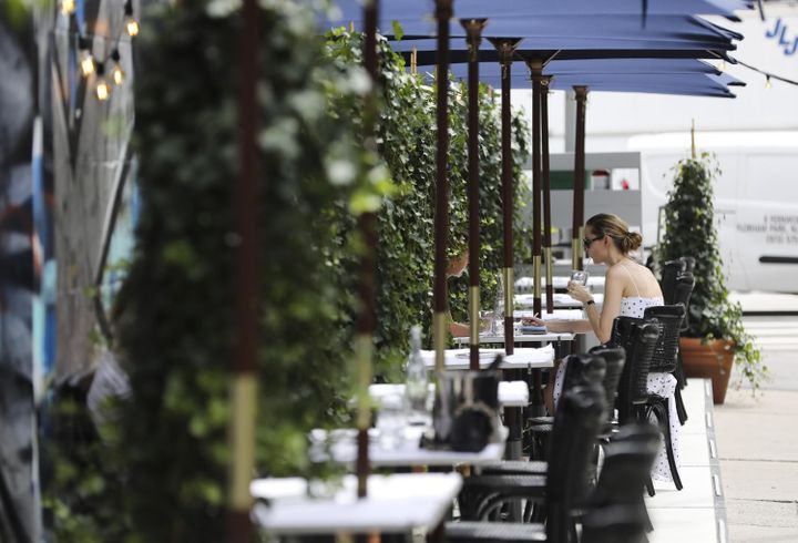 An outdoor dining area in New York City on July 30. Adults who tested positive for the coronavirus were roughly twice as