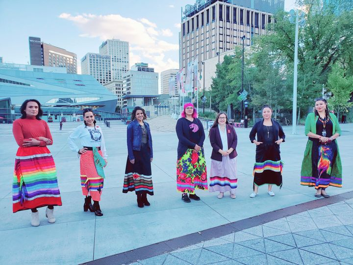 """Chevi Rabbit, Charlene Roan-Shirt, Ashleigh Mihko Pîwâyesis, April Eve Medicinespiritdancer, Katherine Swampy, Jacqueline Buffalo, Rhea Fraser, and Marilyn Tobbaccojuice are all lending their support to """"Walk A Mile In A Ribbon Skirt."""""""