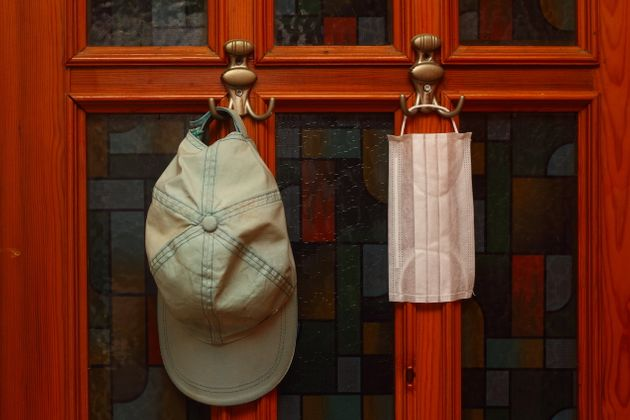 N95 mask hangs near the front door during quarantine.