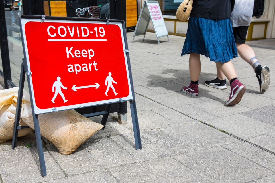 A social distancing sign asking people to keep apart when walking in the market town of Wimborne Minster in Dorset, UK.