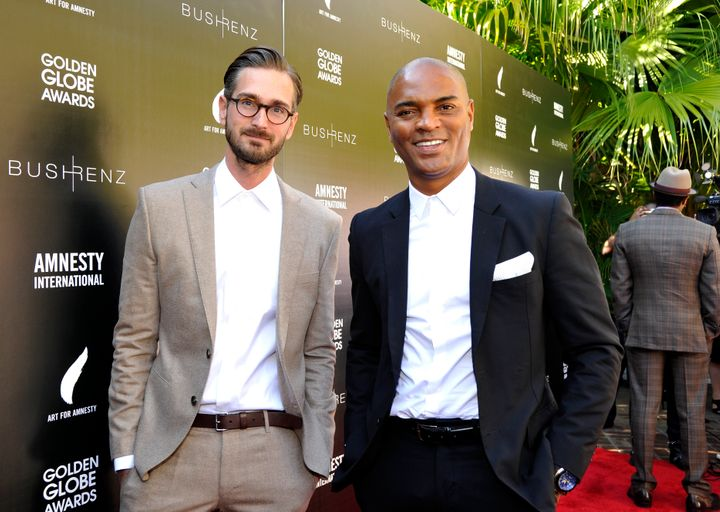 Christopher Renz and Gerard Bush attend an Art for Amnesty brunch in 2016.