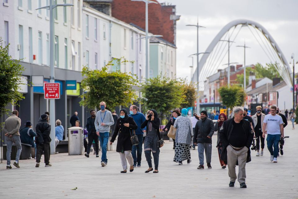 Members of the public wear face masks in Bolton town centre as coronavirus restrictions are tightened in the area on September 9.