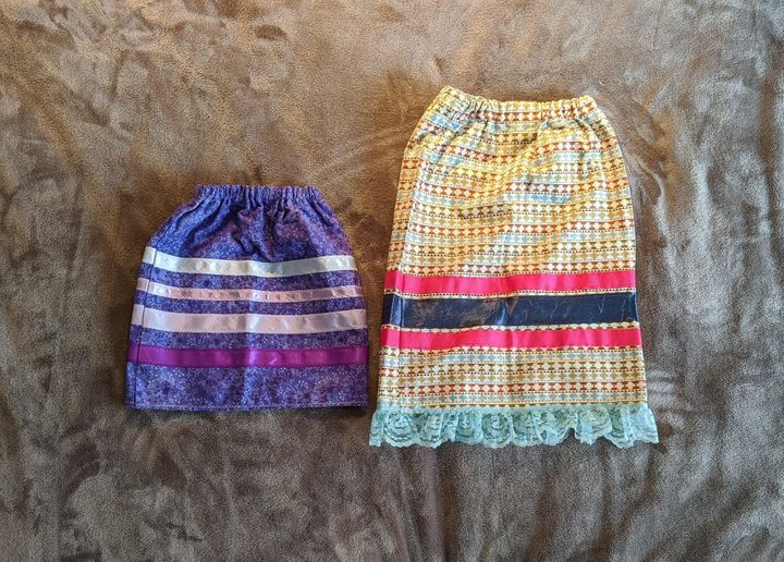 Rhea Fraser and her family are making a generous donation of several ribbon skirts to the event, including these short, small-sized ones.