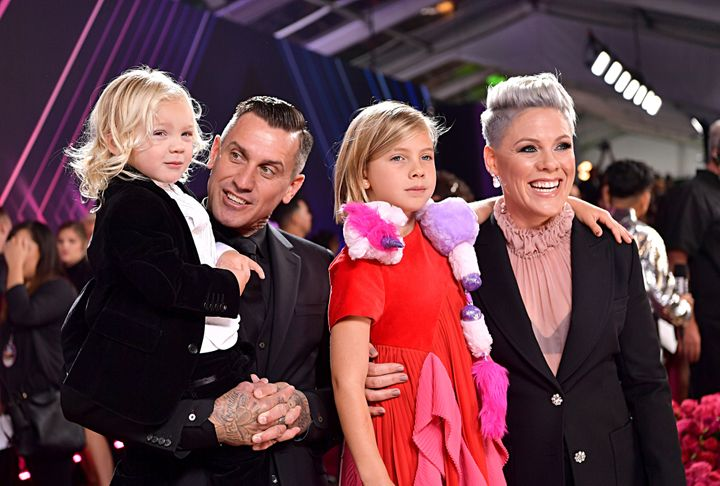 Carey Hart and Pink with their children, Jameson and Willow Sage Hart, at the 2019 E! People's Choice Awards red carpet.