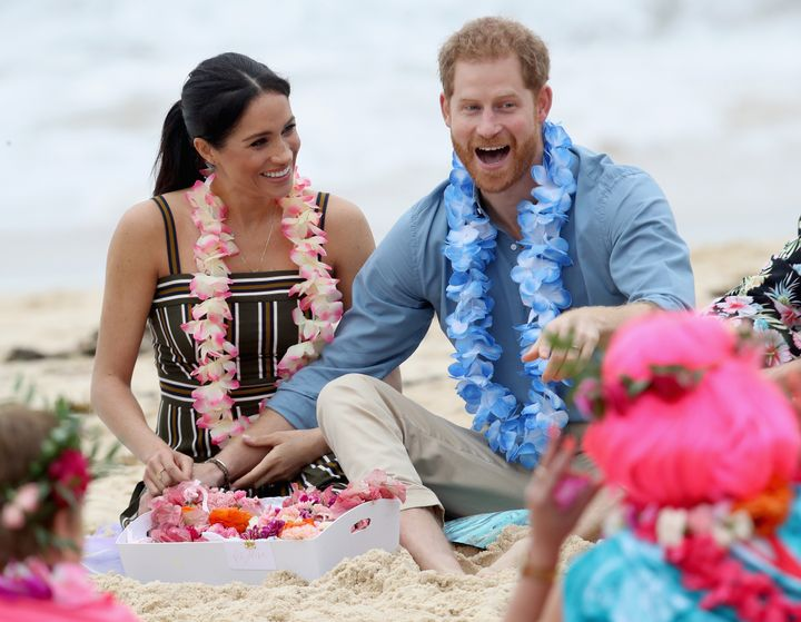 Prince Harry and Meghan Markle enjoying themselves at South Bondi Beach in Sydney, Australia on Oct. 19. 2018.