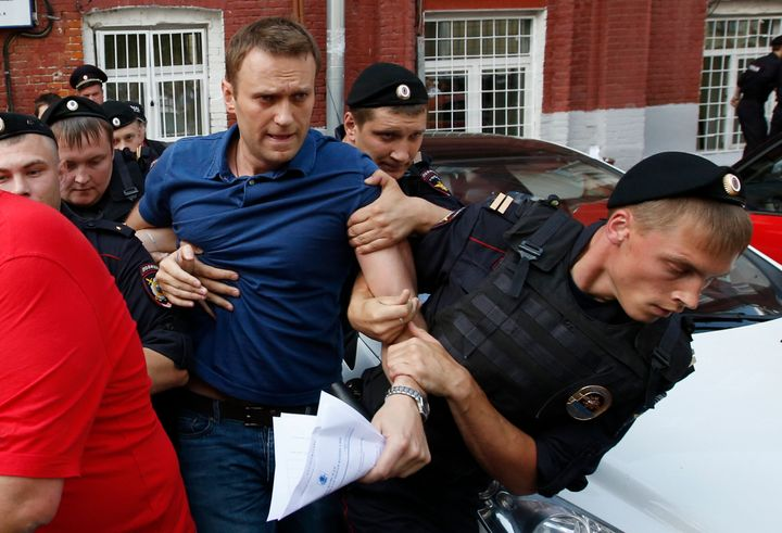 Navalny, who has vowed to destroy the political system under President Vladimir Putin, is seen being detained by police