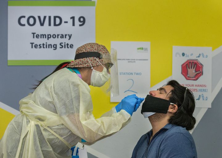 Dr. Nandini Sathi swabs Ander Malevran for a COVID test at a pop-up testing site set up by Michael Garron Hospital in Toronto. Identifying the testing site closest to you is a helpful way to prepare for a possible outbreak.