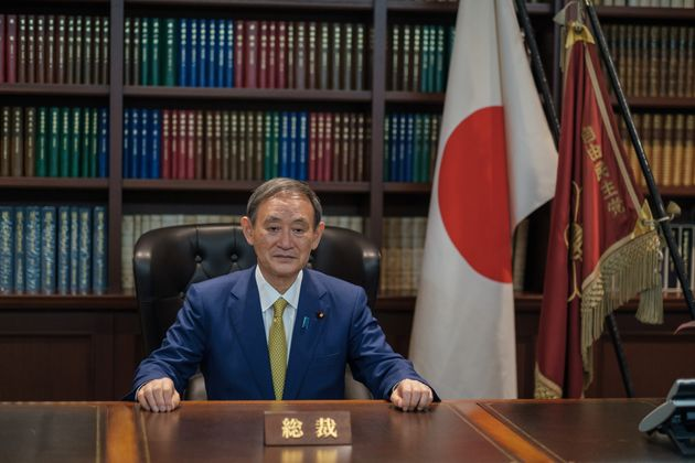 Yoshihide Suga poses for a picture following his press conference at LDP (Liberal Democratic Party) headquarters,...