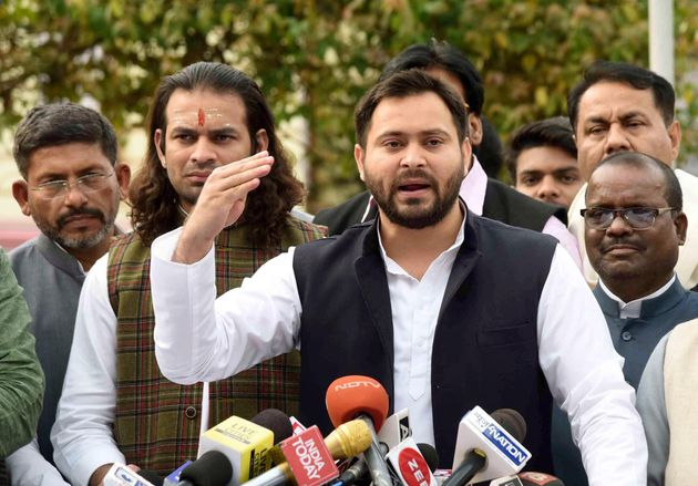 RJD leader Tejashwi Yadav and his brother Tej Pratap Yadav in file