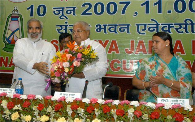Rashtriya Janta Dal (RJD) President Lalu Prasad Yadav with Raghuvansh Prasad Singh and Rabari Devi in...