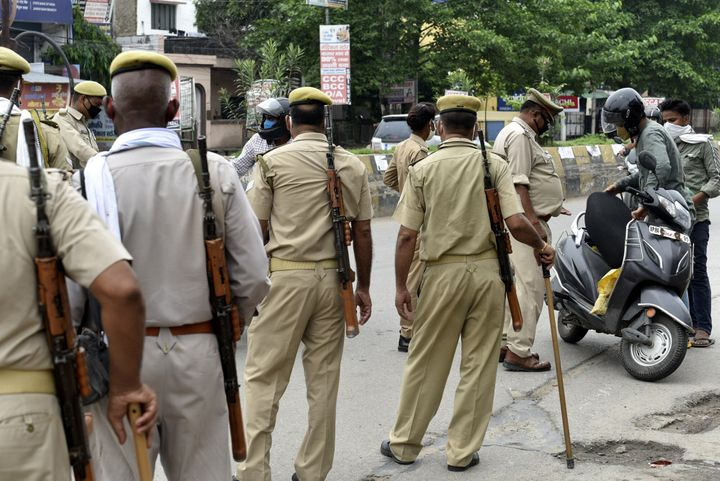 Uttar Pradesh Police personnel screen commuters during the lockdown at Kursi Road, on July 19, 2020, in Lucknow.