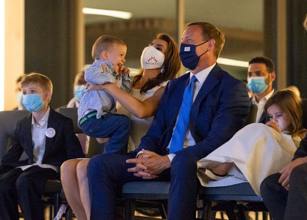 Peter MacKay wears a mask surrounded by his wife and three children in Ottawa on Aug. 23. He says he's...