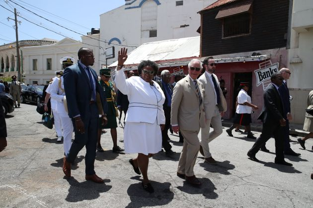 Prince Charles during a walkabout with the Prime Minister of Barbados, Ms Mia Mottley in Bridgetown,...