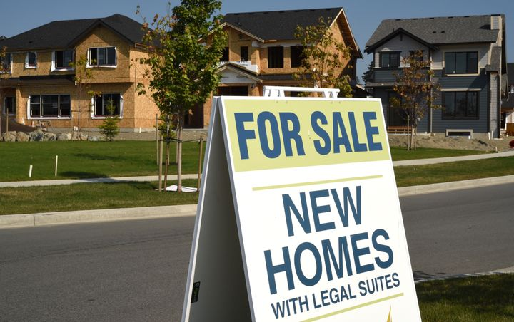 A sign advertises new homes for sale in Colwood, B.C., on Sept. 10, 2020. The national average home price set a new record in August at more than $586,000.