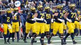 ANN ARBOR, MI - NOVEMBER 30:  The Michigan offensive line heads onto the field after a kickoff return during a regular season Big 10 Conference game between the Ohio State Buckeyes (2) and the Michigan Wolverines (10) on November 30, 2019 at Michigan Stadium in Ann Arbor, Michigan. (Photo by Scott W. Grau/Icon Sportswire via Getty Images)