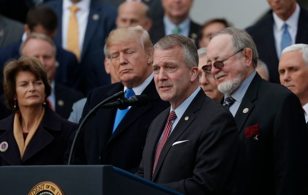 Sen. Sullivan, foreground, speaks at a ceremony celebrating Donald Trump's tax cuts. His fortunes could...