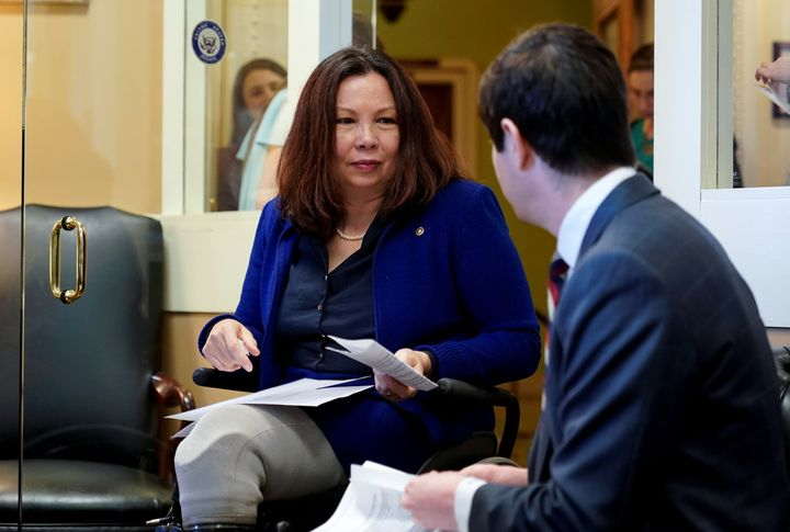 Sen. Tammy Duckworth (D-Ill.) speaks with an aide in Washington, D.C., March 27, 2019.