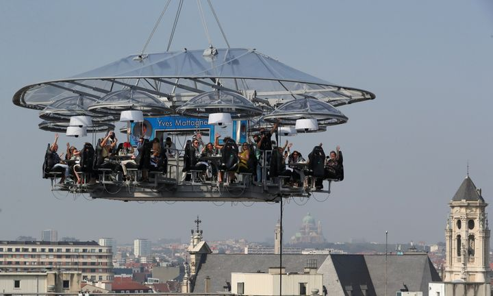 "A nine tons structure that can accommodate a total of thirty two guests, suspended from a crane at a height of fifty meters is seen during an event known as ""Dinner in the Sky 2.0 New Generation"" in Brussels, Belgium September 16, 2020. REUTERS/Yves Herman"
