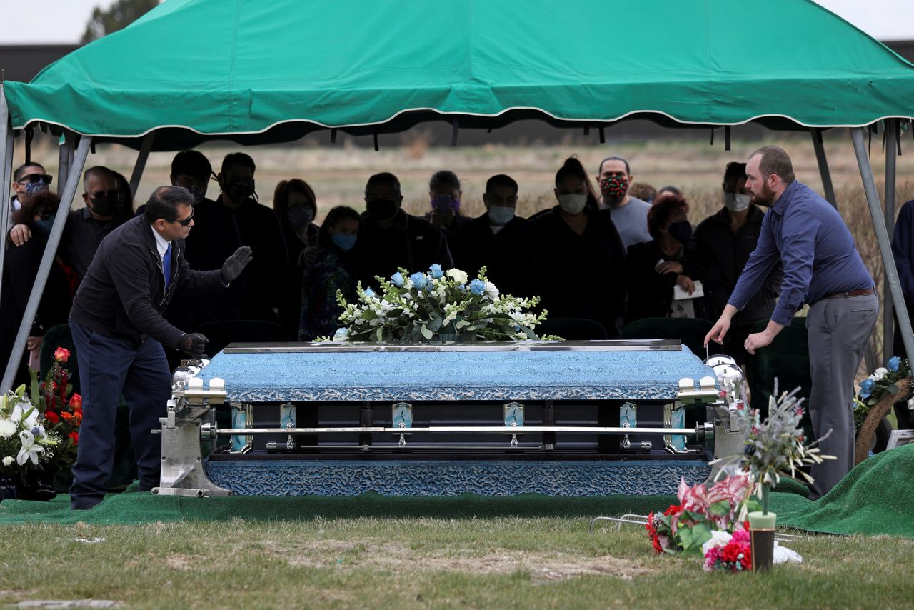 Mourners attend the funeral for Saul Sanchez, a worker at the JBS meatpacking plant in Greeley, Colorado, who died of COVID-19. OSHA fined the plant $15,615 for coronavirus-related hazards -- an example of the meager fines the agency is issuing in response to inadequate safety conditions amid the pandemic.
