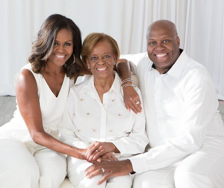 Michelle Obama with her mother, Marian Robinson, and brother, Craig Robinson.