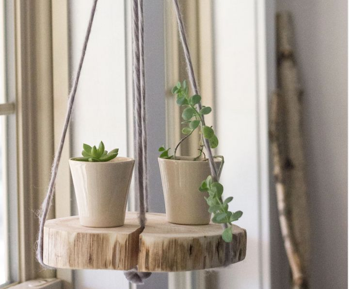 This suspended plant shelf is made with sweet-smelling cedar.