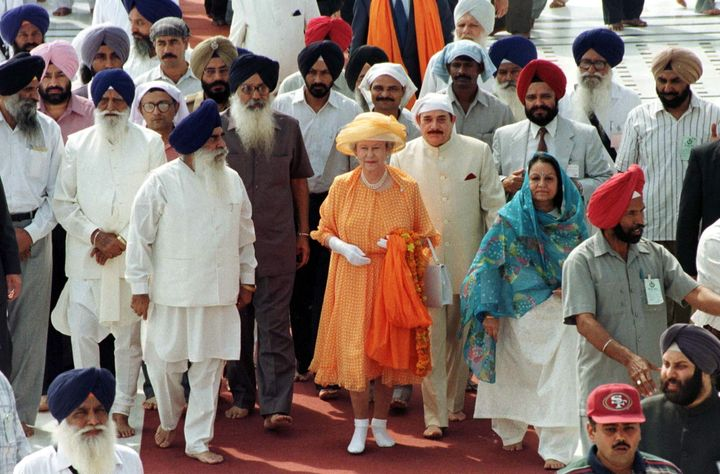 Queen Elizabeth removed her shoes to visit the Golden Temple Of Amritsar in Punjab, India. She later laid a wreath at the site where British soldiers killed nearly 400 unarmed protesters in 1919.