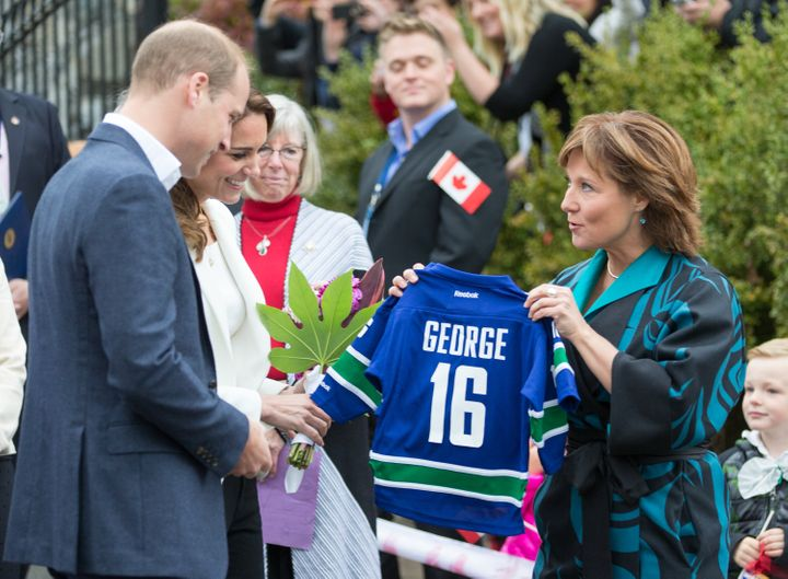 Catherine, Duchess of Cambridge and Prince William, Duke of Cambridge are given a gift for their son George as they visit the Cridge Centre for the Family on Oct. 1, 2016 in Victoria, B.C. during a royal tour of Canada.
