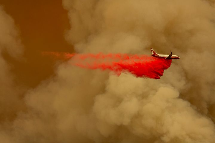 A firefighting tanker jet drops fire retardant to slow the Bobcat fire in the Angeles National Forest on Sept. 10.