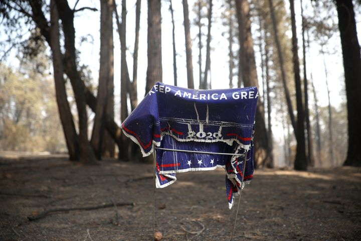 A melted Trump campaign sign sits in front of a home in Butte County that was destroyed by the North Complex fire, which has