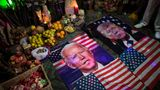 Images of Democratic presidential candidate Joe Biden and his rival, U.S. President Donald Trump, lay on altar during a ceremony, inside an apartment in Lima, Peru, Wednesday, Sept. 16, 2020. Peruvian shamans gathered to perform a ritual they believe will curtail the spread of the COVID-19 pandemic around the world, and to predict who will win the upcoming U.S. presidential election. (AP Photo/Rodrigo Abd)