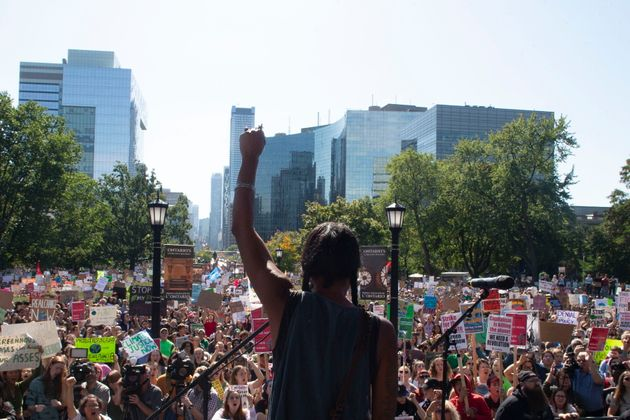 First Nations activist Caroline Crawley addresses the crowd as protesters gather outside the Ontario...