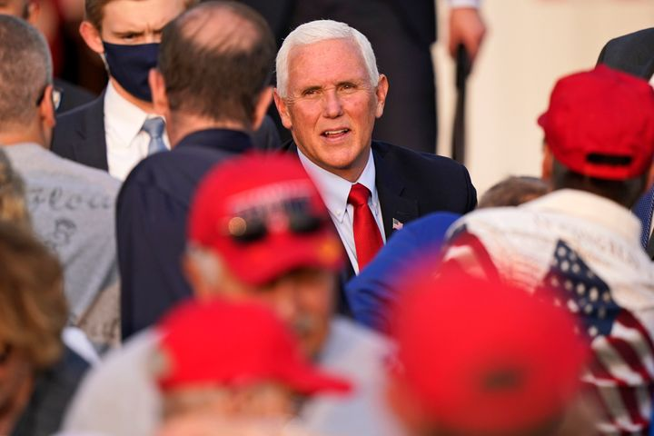Vice President Mike Pence greets supporters Wednesday in Zanesville, Ohio. Earlier this week, Pence withdrew from attending a