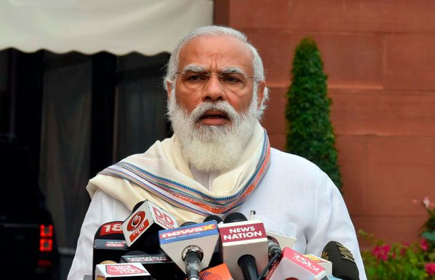 In this photo released by the Press Information Bureau, Prime Minister Narendra Modi addresses the media...