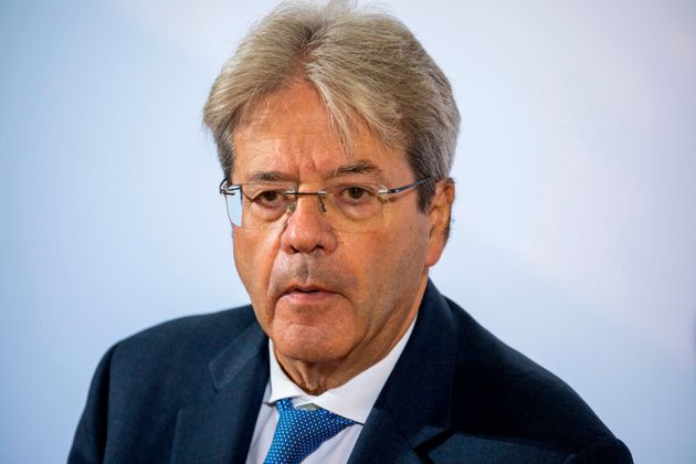 European Commissioner for Economy Paolo Gentiloni speaks to media on his arrival for the second day of...