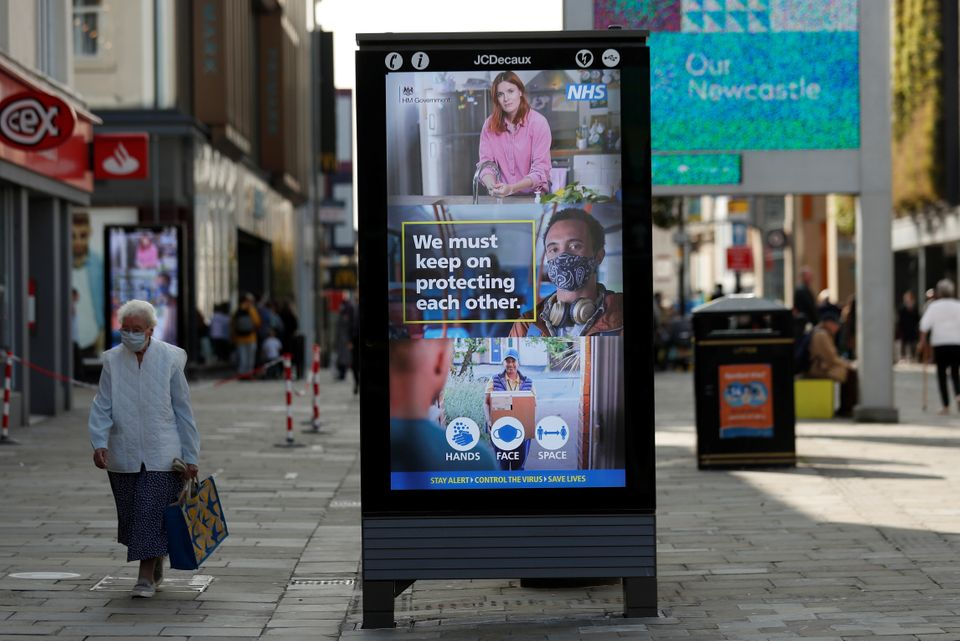 A sign of precautionary health and safety measures is seen on Northumberland Street, amid the coronavirus outbreak in Newcastle.