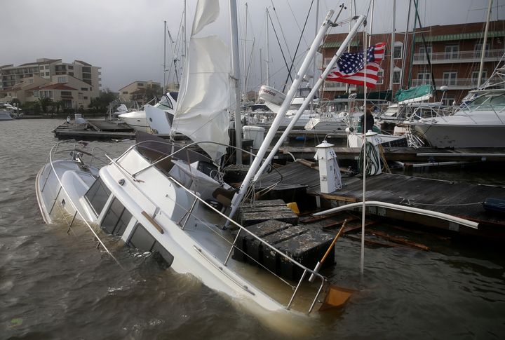 A U.S. flag flies from a boat damaged by Hurricane Sally in Pensacola, Florida, on Wednesday.