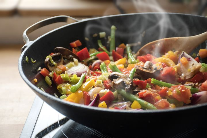 Toss your takeout into a wok and stir fry it up with fresh vegetables from your fridge or freezer.