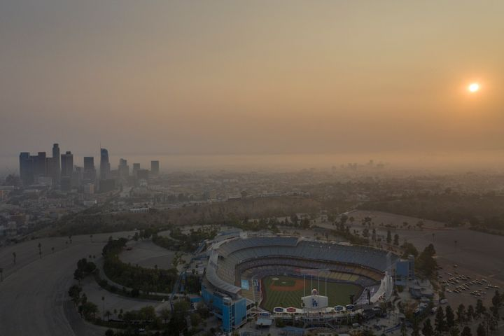 Professionals have to recognize when it's no longer OK to push through work during a disaster. Above, the Los Angeles skyline and sunset is obscured by smoke, ash and smog on Sept. 14.