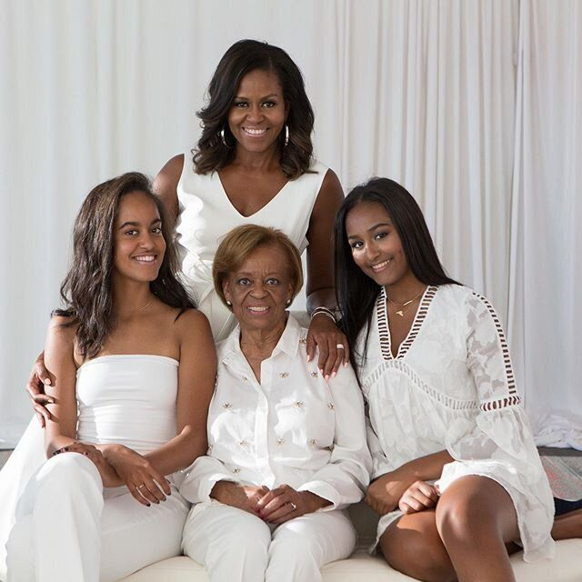 Michelle Obama with her daughters Malia (left) and Sasha (right), and her mother Marian Robinson.