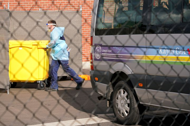 Medical personnel disposes medical waste outside the Kalyna Aged Care facility amid the second wave of the coronavirus disease.