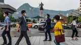 SEOUL, SOUTH KOREA - 2020/09/15: People wearing face masks are seen walking road street. South Korea reported 106 more cases of the COVID-19 as of 0:00 a.m. Tuesday  local time compared to 24 hours ago, raising the total number of infections to 22,391. (Photo by Simon Shin/SOPA Images/LightRocket via Getty Images)