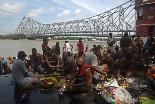 Devotees perform rituals on the bank of river Hooghly to mark the occasion of Mahalaya, at Jagannath...