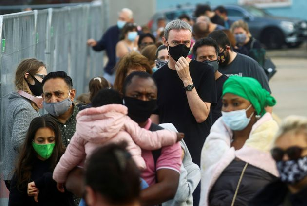People queue at a test centre following an outbreak of the coronavirus disease (COVID-19) in Southend-on-sea